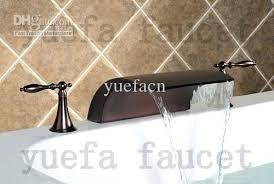 bronze waterfall bathroom faucet antique oil rubbed bronze widespread waterfall bathroom sink faucet