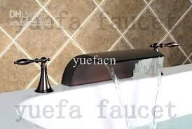bronze waterfall bathroom faucet antique oil rubbed bronze widespread waterfall bathroom sink faucet
