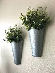 this is a unique set of two galvanized metal wall planters you have the options adding