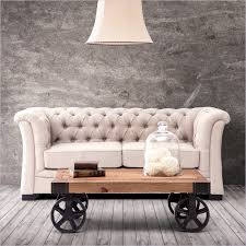 best nicole miller home decor with chesterfield sofa in cream tone with vintage wooden coffe table