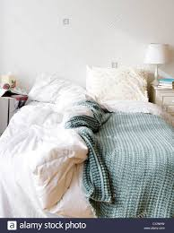 unmade bed side view. USA, New Jersey, Jersey City, Messy Bed In Bedroom - Stock Image Unmade Side View L