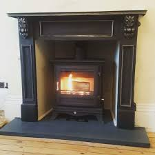chesney beaumont multi fuel stove with solid slate fireplace hearth and cast iron fire surround contemporay fireplace for a victorian house
