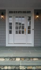 white front door. Transome And Sidelites With Wood 3/4 French Front Door Painted White. Bluestone River Rock. Black Carriage Lamps, Gold Hardware Seashell White F