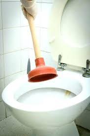 toilet backing up into bathtub bathtub backing up toilet and shower backed up plunging clogged toilet