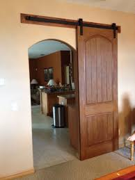 the matching arched barn door pliments the entry opening and is paired