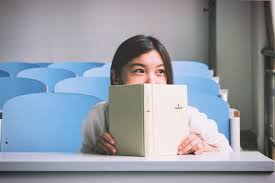 Image result for teen reading a book