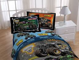 pure white kids bedroom interior with small table lamp set beside black monster truck comforter bedding