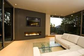 linear fireplace with tv above gas