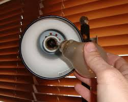 remove broken light bulbs without getting cut or shocked using a water bottle 3 steps with pictures
