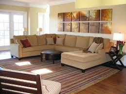 striped sofas living room furniture. Cream Microfiber Large Sectional Sofa Having Chaise Lounge And Round Coffee Table On Striped Carpet Beige Hardwood Floor Sofas Living Room Furniture