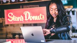 free images black leather jacket blogger business checking computer desk device donut expression indoors internet laptop looking