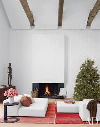 in a hamptons living area by d apostrophe design a minimalist fireplace blends into