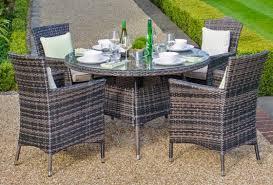 nova amelia 4 seat rattan dining set with round table