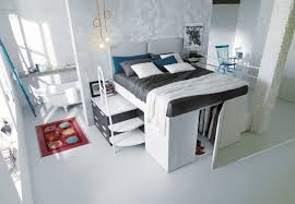 space saving furniture table. Smart Spacesaving Bed Hides A Walkin Closet Underneath Space Saving Furniture Table
