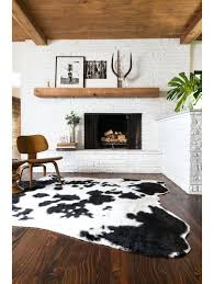 interior faux zebra hide rug with chair and white round table on inside faux animal skin