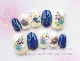 メルカリ 和装に青と水色のお花と帯締め模様の和柄のネイルチップ