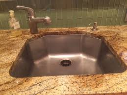 a reader wants to get rid of chemical marks from oven cleaner on a stainless steel sink reader photo
