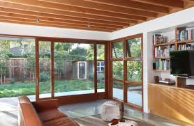 View in gallery Large sliding glass doors within a wooden frame