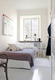 How To Make Your Room Look Bigger Small Bedroom With White Paint Wall Color Make Your Room Look
