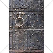 ancient iron door handle on iron meval door