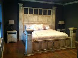using the panels of an old door to frame a king sized bed