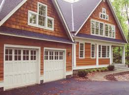 avalon collection of barn style swing and folding style doors by artisan custom doorworks