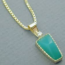the elk ivory jewelry designs you will see on this are made of 18 karat yellow gold and a variety of precious gemstones the jewelry exudes warmth