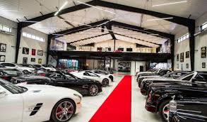 man cave. The Car Lover Will Find This Must-have Man Cave A True Dream Come True. Incredible Space Includes Italian Porcelain Flooring, Two Custom Spiral