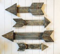 wooden arrow wall art by designsbyloulabelle on etsy on wall art wooden arrow with diy rustic wood arrow with steps pinterest wood arrow rustic