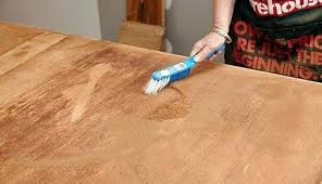 dusting wood furniture. How To Restore Wood Furniture Person Brushing Dust Off Table Without Refinishing Dusting D