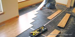 how to lay laminate flooring lminte laying under kitchen cabinets around metal door frames