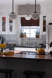 traditional kitchen design with pendant lighting by schoolhouse