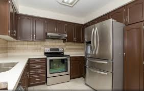 painted kitchen cabinets after realtor spray painting cabinet refinishing and sharrardpainting professionally cost of your spraying