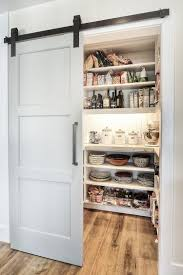 ... Modern pantry design with an elegant sliding barn door [Design:  Dwellings Design Group]
