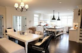 beautiful kitchen design with white turned leg dining table linen slipcover bench slipper chairs and black wicker dining chairs