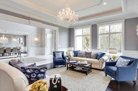 traditional luxury living room with tray ceiling and glass chandelier