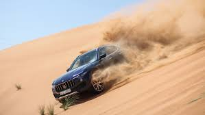 2018 maserati levante changes.  changes the maserati levante lets loose a spray of sand while descending desert  dune throughout 2018 maserati levante changes