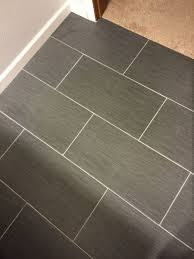 flooring  when tiling a floor must i start in the middle of the