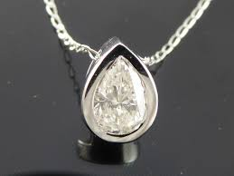 white gold solitaire pendant with 1 pear cut diamond of 0 65 ct no