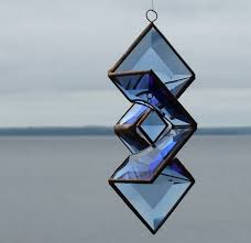 popular items for outdoor garden art on blue beveled stained glass sundrop star hanging sculpture indoor