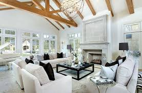 cottage living room with restoration hardware belgian track arm slipcovered sofa stone fireplace exposed