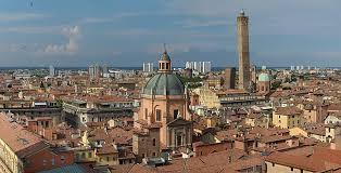 view from the top of the basilica di san petronio in center the dome of santuario di santa maria della vita right due torri asinelli higher and