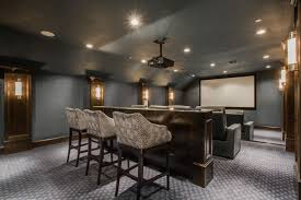 The state-of-the-art addition below includes everything you would expect  from a media room, plus a decorative ceiling and sound absorption panels.