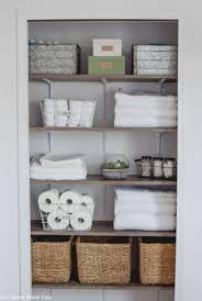 a diy but custom shelving system for a linen closet makeover check out the organizational