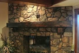 reclaime wood fireplace mantel with mountain stone fireplace wall accent for rustic home interior