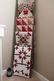 Displaying quilts - interesting use of a ladder | ReNew It ... & Displaying quilts - interesting use of a ladder | ReNew It | Pinterest |  Ladder, Love this and A ladder Adamdwight.com