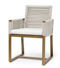 palecek s san martin outdoor arm chair with a teak wood frame and legs features a natural