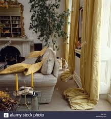 Silk Curtains For Living Room Yellow Silk Curtains Falling In Pools In Eighties Livingroom With