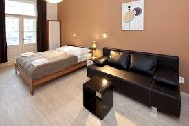 living room with bed:  living bedroom with kitchen studio dusni b apartments prague hotel wenceslas