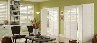 sliding glass door and bi fold shutters